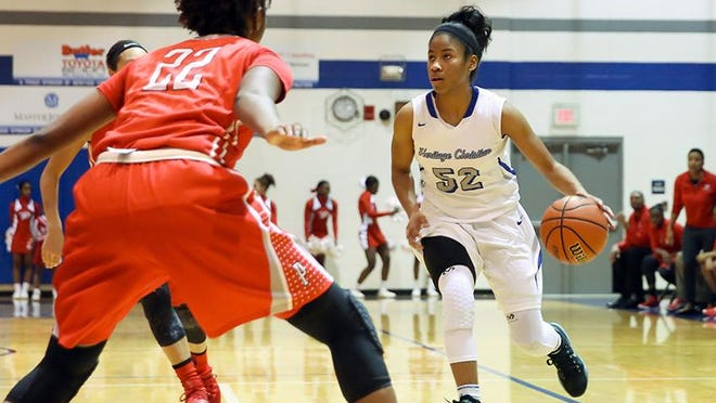 Heritage Christian's Tyasha Harris looks to score during the Eagles' win over Pike on Saturday.