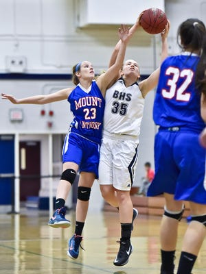 Morgan Hewitt, left, and the Mount Anthony Union High School girls basketball team move back into the top 5 in this week's power rankings.