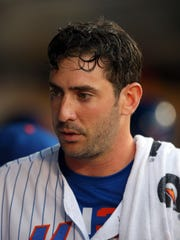 Mets starting pitcher Matt Harvey (33) in the dugout