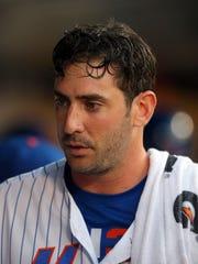 Mets starting pitcher Matt Harvey (33) in the dugout