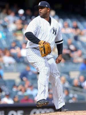 Sep 30, 2017; Bronx, NY, USA; New York Yankees starting pitcher CC Sabathia (52) pitches against the Toronto Blue Jays during the second inning at Yankee Stadium. Mandatory Credit: Brad Penner-USA TODAY Sports