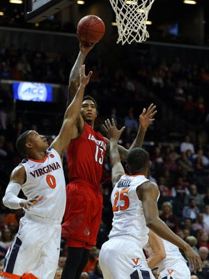 Louisville Cardinals forward Ray Spalding (13) shoots against Virginia Cavaliers guard Devon Hall (0) and forward Mamadi Diakite (25) during the first half of a quarterfinal game of the 2018 ACC tournament at Barclays Center.