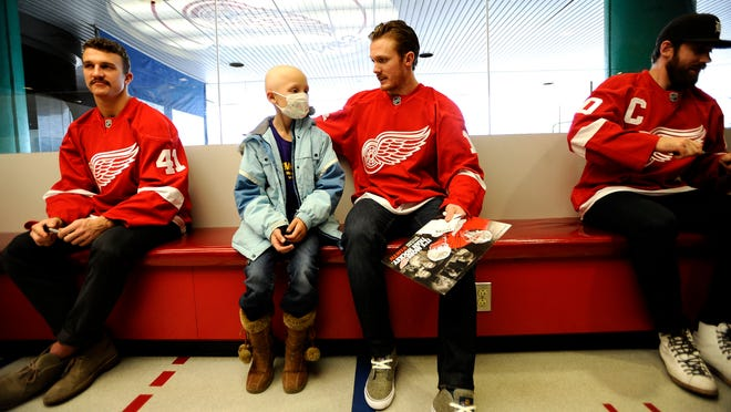 Natalie Yale, 7, of Marysville chats with Gustav Nyquist, right, while Luke Glendening sits nearby.