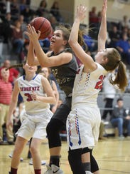 Izard County's Bethany Simmons is fouled by Melbourne's