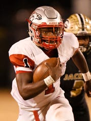 South Pointe's Derion Kendrick (1) leaves a Greer defender.