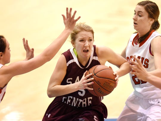 Kelsey Peschel drives to the basket for Sauk Centre