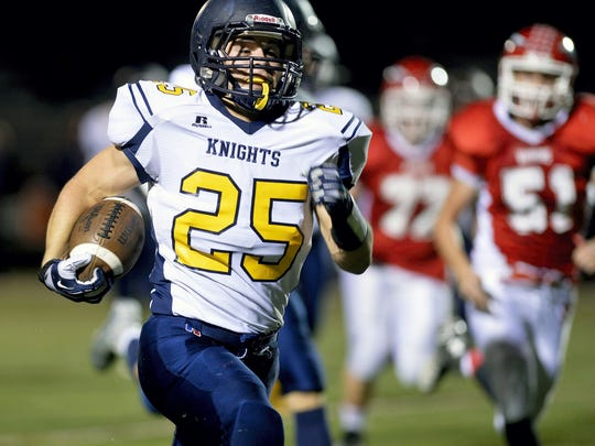 Eastern York's David Livelsberger rushes for a touchdown last year against Susquehannock. Eastern is currently a 3A school among the PIAA's four classifications. If it expands to six, the Golden Knights could be the smallest 4A school. With a 10-percent rule, they could drop to 3A in such a format. (FILE -- GAMETIMEPA.COM)