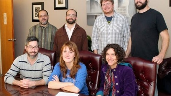 The Honeycutters sign with Organic Records. Front to back & left to right: Ty Gilpin (Organic Records), Amanada Anne Platt, Erin Scholze (Dreamspider Publicity),  Tal Taylor, Josh Milligan, Rick Cooper and Matt Smith.