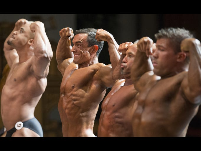 Bodybuilders flex for judges on Saturday, May 30, 2015