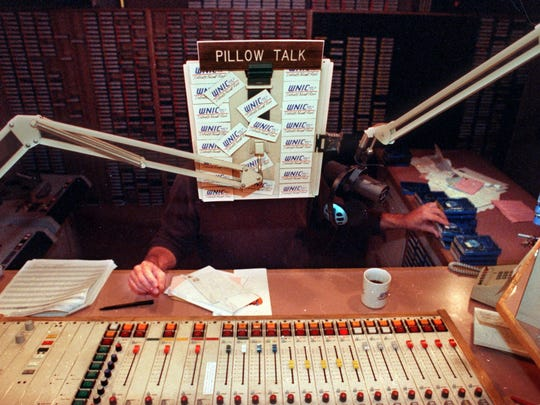 Alan Almond, host of Pillow Talk on WNIC-FM (100.3),  reaches for one of the many carts of easy listening music on Sept. 28, 1993, at the studio in Dearborn.