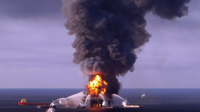 This April 21, 2010 US Coast Guard handout file image shows fire boat response crews as they battle the blazing remnants of the BP operated off shore oil rig, Deepwater Horizon, in the Gulf of Mexico.