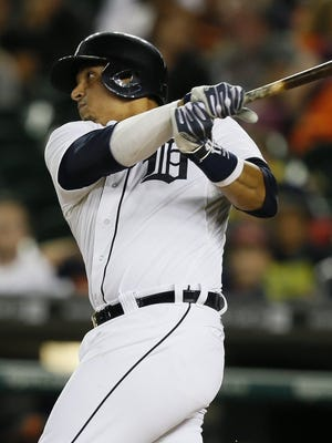 Detroit Tigers Victor Martinez hits RBI double to score Miguel Cabrera for a 6-1 lead over the San Francisco Giants in the seventh inning in Detroit on Sunday, September 7, 2014.