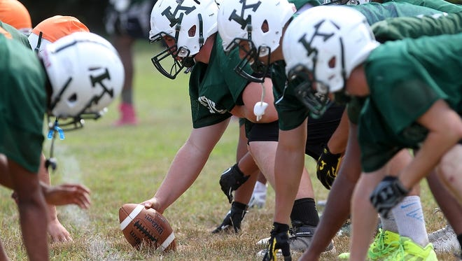 J.F. Kennedy football practice, Monday, August 25, 2014, in Woodbridge, NJ. Photo by Jason Towlen