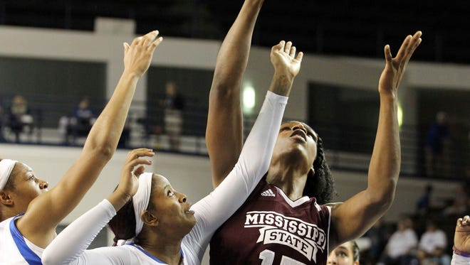 Mississippi State's Teaira McCowan, right, pulls down a rebound near Kentucky's Dorie Harrison, left, and KeKe McKinney, center, during the third quarter of an NCAA college basketball game, Sunday, Feb. 25, 2018, in Lexington, Ky. Mississippi State won 85-63.