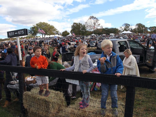 Children watch as the horses in the first race, The Peapack, trot by on their way to the starting line during the 95rd annual Far Hills Race Meeting at Moorland Farm in Far Hills, a fundraiser for Robert Wood Johnson University Hospital. Oct. 17, 2015, Far Hills.