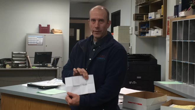 Wisconsin Rapids City Clerk Shane Blaser shows the slip of paper with Steven J. Koth's name on it after a random draw that took place Monday to resolve a tie vote in the District 5 City Council race. Incumbent Andrew Kirkpatrick said he will ask for a recount.