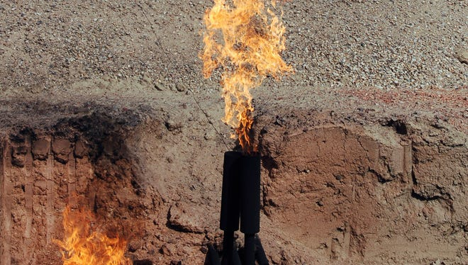 Natural gas from an oil well near Parshall, N.D.