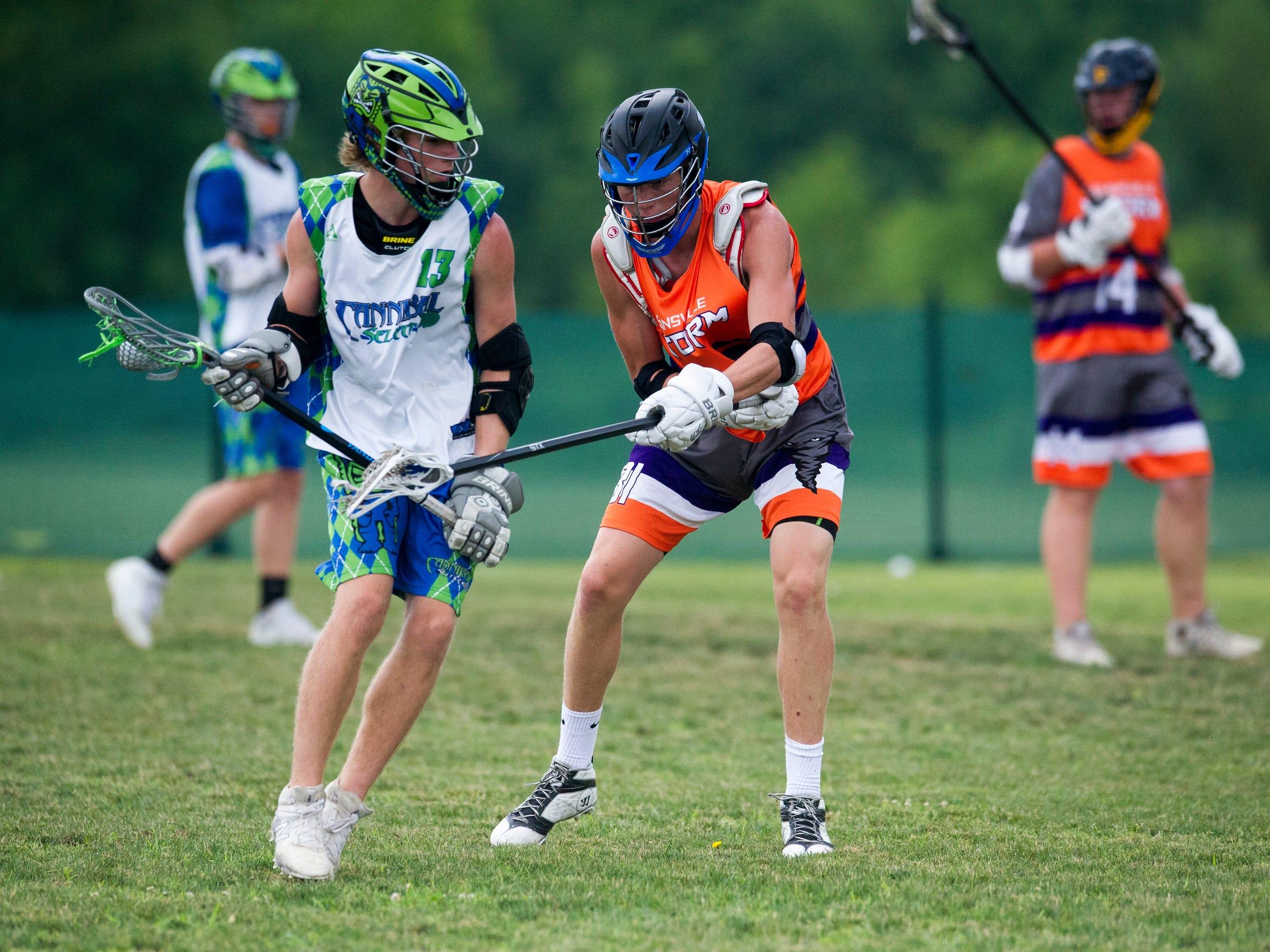 Eville Storm U19's Joseph W. stick checks a Cannibal High School player during the 2018 Thunderbolt Shootout on Sunday, June 10, 2018.
