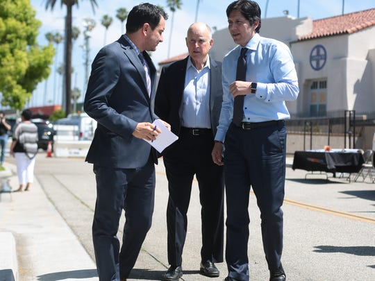 California Governor Jerry Brown, center, Assembly Speaker Anthony Rendon, left and Senate President Pro Tem Kevin de Leon, right, in Riverside on Tuesday, April 4, 2017, to support the Road Repair and Accountability Act or SB 1.
