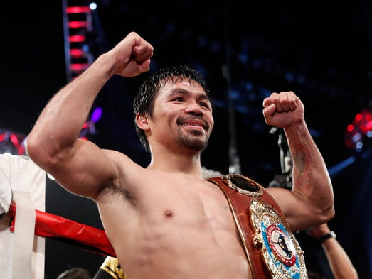 Manny Pacquiao celebrates after defeating Jessie Vargas