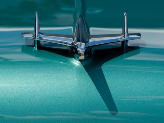 The hood ornament of a 1955 Chevy Bel Air.