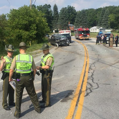 Vermont State Police troopers investigate a crash along