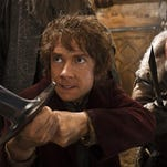 "Martin Freeman (left) and John Callen are shown in a scene from ""The Hobbit: The Desolation of Smaug."""