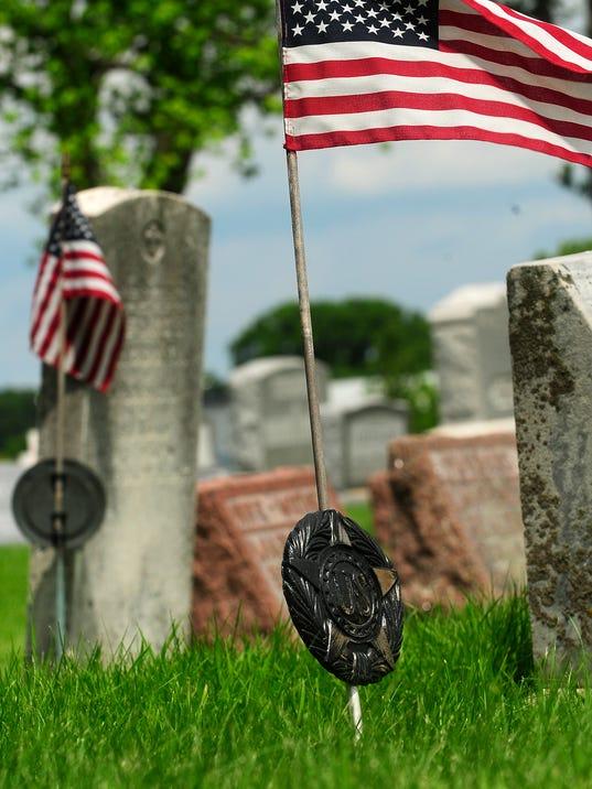 FON 070814 brass grave markers 2.jpg