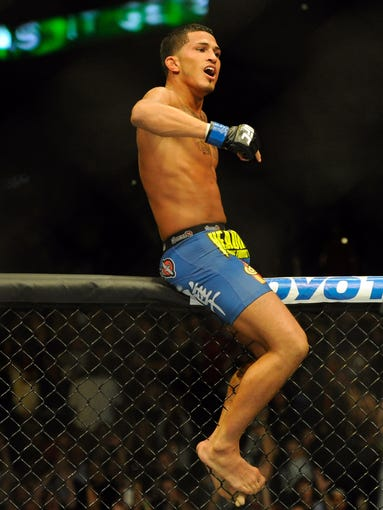 Anthony Pettis reacts after beating Benson Henderson (not pictured) to win the Lightweight Championship during the UFC-164 bout at BMO Harris Bradley Center.
