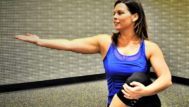 Wendy Sly gets in some yoga at the Planet Fitness in Milford.