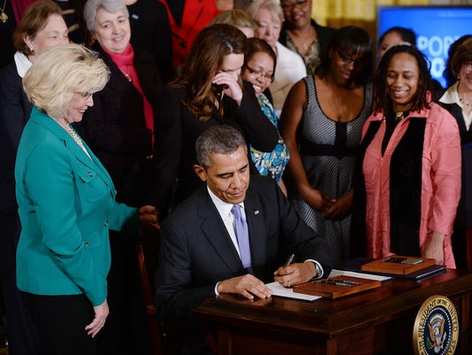 Obama signs executive order for equal pay