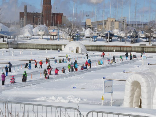 Children ice fishing in the Village Nordik at the Port of Quebec.