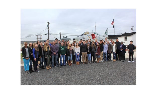 MILLVILLE - Congressman Frank LoBiondo, NJ-02, third from right, met with his 2015-2016 Congressional Youth Advisory Council on Jan. 9 at Millville Airport, for its quarterly conference to discuss current events in government. The meeting was hosted by the Millville Army Air Field Museum. The council of students represents more than 20 southern New Jersey high schools from the second congressional district. The group met for a two-hour workshop in the museum's Henry E. Wyble Historic Research Library and Education Center, and then toured the museum.