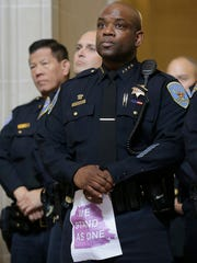 Acting San Francisco Police Chief Toney Chaplin listens to speakers during a meeting at City Hall in San Francisco by city leaders and community activists to reaffirm the city's commitment to being a sanctuary city in response to Donald Trump's support of deportations and other measures against immigrants Monday, Nov. 14, 2016. (AP Photo/Jeff Chiu)