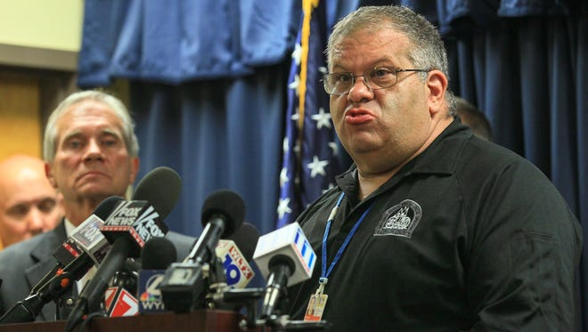 John Skipper, left, Anderson County Sheriff, listens to Scott Stoller, Anderson County EMS & Special Operations Director, speak during a 9 p.m. press conference at the Anderson County Emergency Operations Center in Anderson. The sheriff, coroner, school leaders and emergency officials gave an update about the public about the shootings at Townville Elementary School.