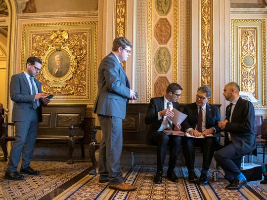 Sen. Al Franken is briefed by his legislative team on Capitol Hill on May 18, 2017.