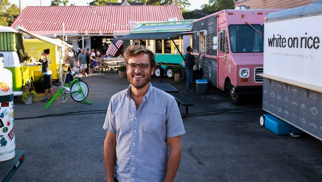 Gary Jonas, owner, The Little Fleet, a food truck park/bar stands in the middle of he business in downtown Traverse City on Tuesday September 22, 2015. Jonas moved from Brooklyn to Traverse City and bought the space that was a former liquor/party store that he turned it into a year-round bar with a seasonal food truck park in the former parking lot on Front Street.
