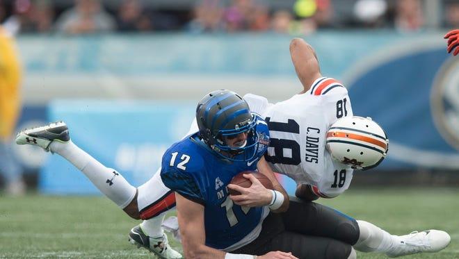Auburn defensive back Carlton Davis (18) tackles Memphis quarterback Paxton Lynch (12) during the NCAA football game in the Birmingham Bowl on Wednesday, Dec. 30, 2015, at Legion Field in Birmingham, Ala.