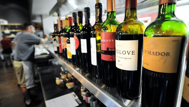 Bottles of wine line the bar at Rockstone Pizzeria & Pub in Fishers, owned by local restaurateur Ed Sahm.