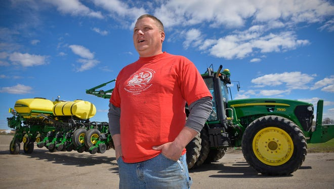 MIke Landwehr, partner and owner in charge of crops and feeding at Landwehr Dairy in Watkins, talks Friday, April 29, about his plans to start planting the 1,000 acres of land he farms on Monday or Tuesday. He's been delayed by recent rains. The corn and alfalfa he plants will be used toward feeding the 850-900 dairy cows they have. It takes a lot of seed to plant 1,000 acres. One bag of seed plants about two-and-a-half acres, he said.