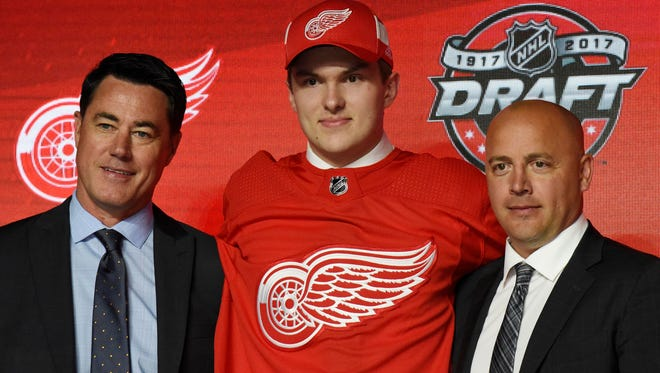 Michael Rasmussen poses for photos after being selected as the No. 9 overall pick to the Detroit Red Wings in the first round of the 2017 NHL Draft at the United Center.