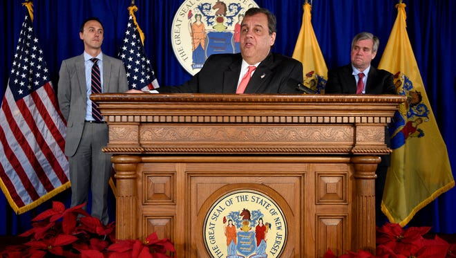 Gov. Chris Christie, with state Treasurer Ford Scudder, left, and commission member Tom Byrne, announced Wednesday that the New Jersey Pension and Health Benefit Study Commission had issued its fourth and final report on reforming public-sector pension and health benefit costs.