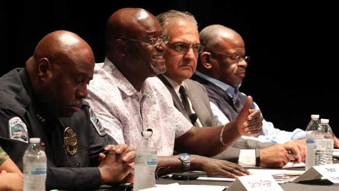 Pastor William Glover answers a question during The News-Press Town Hall at Dunbar High School.