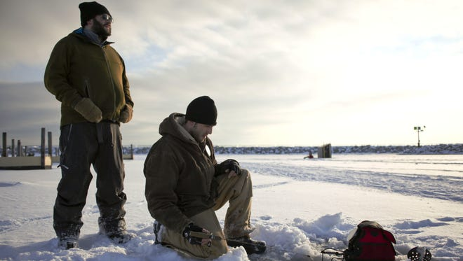 Anglers wait for a bite at the Lexington Harbor. Clay Township firefighters had to pull a fisherman from Little Muscamoot Bay after his four-wheeler crashed through the ice.