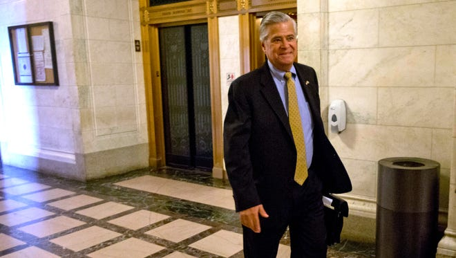 New York Senate Majority Leader Dean Skelos, R-Rockville Centre, arrives to his office at the Capitol on Monday.