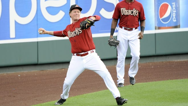 Will Ferrell throws the ball in during Thursday's game between the Reds and Diamondbacks in Scottsdale, Ariz.