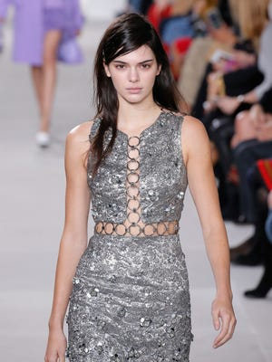 Model, Kendall Jenner, walks the runway wearing Michael Kors Fall 2016 during New York Fashion Week.