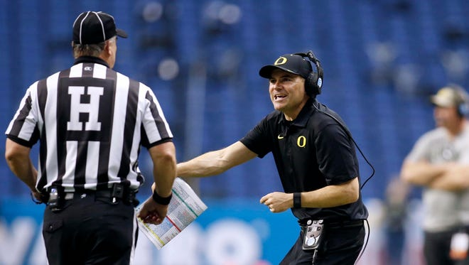 Jan 2, 2016; San Antonio, TX, USA; Oregon Ducks head coach Mark Helfrich argues a call with an official during the game against the TCU Horned Frogs in the 2016 Alamo Bowl at the Alamodome. Mandatory Credit: Erich Schlegel-USA TODAY Sports