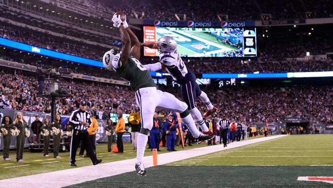 Quincy Enunwa hauls in a memorable touchdown catch in a Week 12 loss to the Patriots.