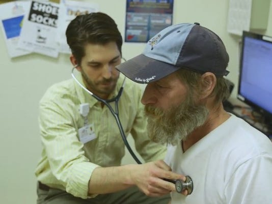 Doctor examines patient at Bell-Aire Motel